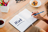 Work  against man writing notes on diary