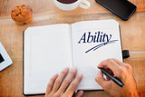 Ability against man writing notes on diary