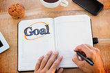 Goal  against man writing notes on diary