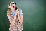 Composite image of geeky hipster woman singing into a microphone