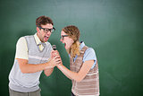 Composite image of geeky hipster couple singing into a microphone