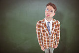 Composite image of geeky hipster looking up