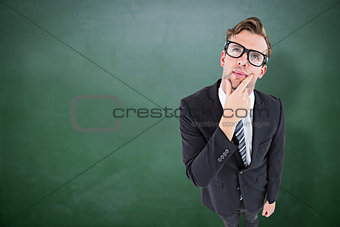 Composite image of thoughtful geeky hipster businessman looking up