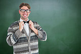 Composite image of happy geeky hipster with wool jacket
