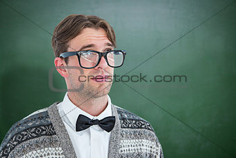 Composite image of thoughtful geeky hipster