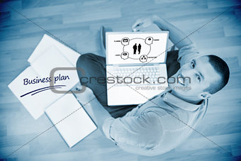 Business plan against young creative businessman working on laptop