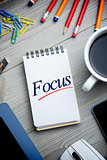 Focus against notepad on desk