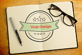 Web design against overhead of open notebook with pen and glasses