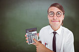 Composite image of geeky smiling businessman showing calculator