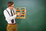 Composite image of geeky businessman using an abacus