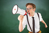 Composite image of geeky businessman shouting through megaphone