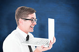 Composite image of geeky businessman holding his laptop
