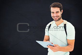 Composite image of student using tablet pc