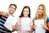 Composite image of smiling students showing their exams