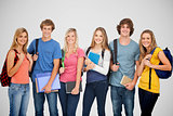 Composite image of smiling students all geared up for college