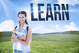Learn against blue sky over green field