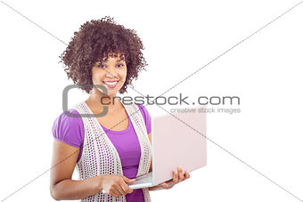 Composite image of student with laptop