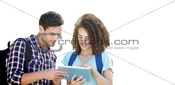 Composite image of students using tablet and smiling
