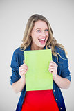 Composite image of smiling student holding notebook