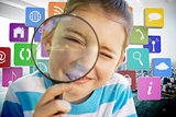 Composite image of cute little girl looking through magnifying glass