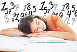 Composite image of sleeping student head on her books