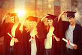 Composite image of group of teenagers celebrating after graduation