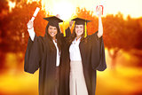 Composite image of two women celebrating their graduation