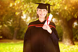Composite image of happy attractive graduate