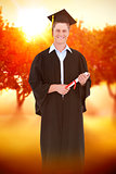 Composite image of a male graduate with his degree in hand