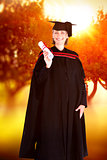 Composite image of happy blonde girl celebrating success with diploma