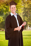 Composite image of a smiling man looking at the camera as he graduates