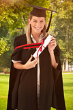 Composite image of woman smiling at her graduation