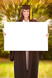 Composite image of full length of a woman holding a blank sheet in front of her as she smiles