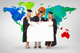 Composite image of three students in graduate robe holding and pointing a blank sign