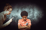 Composite image of female teacher shouting at boy