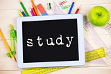 Study against students table with school supplies