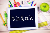 Think against students table with school supplies