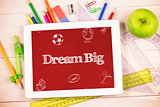 Dream big against students desk with tablet pc