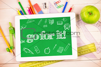 Go for it! against students desk with tablet pc