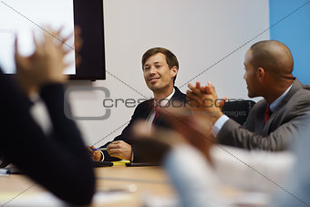 Business Man Doing Presentation And People Applauding In Meeting