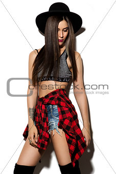 Beautiful young woman with long hair posing on wight background.