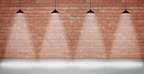 Brown brick wall lightened with four lamps