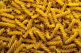 Fusilli pasta background. Italian cuisine.