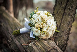 Beautiful bouquet of white flowers on wood