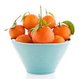 Tangerines on ceramic blue bowl
