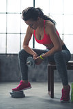 Fitness woman with dumbbell in loft gym