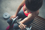 Closeup on woman lifting dumbbell