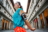 Young female in sports outfit next to Uffizi gallery in Florence