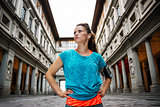 Fitness young sporty woman in front of Uffizi gallery, Florence