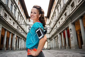 Portrait of smiling fitness woman with mp3 player, Florence